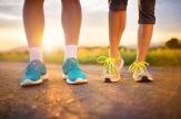 31166419 - runner feet. running couple closeup of running shoes.